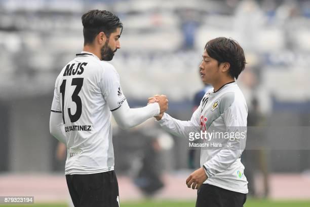 Carlos Martinez of Tokyo Verdy talks with Yoshiaki Takagi during the JLeague J1 Promotion PlayOff semi final match between Avispa Fukuoka and Tokyo...