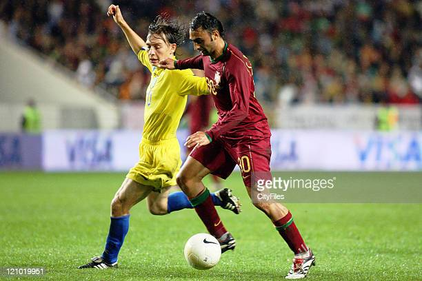 Carlos Martins and Ruslan Baltitev during a qualifying match between Portugal and Kazakhstan national team in Coimbra Portugal on November 16 2006
