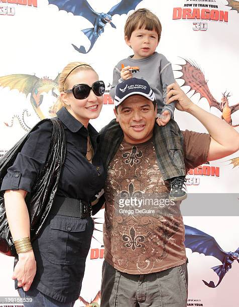 """Carlos Mencia, wife Amy and son Lucas arrive at the Los Angeles Premiere of """"How To Train Your Dragon"""" at the Gibson Amphitheatre on March 21, 2010..."""