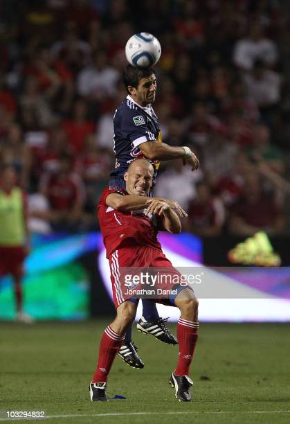Carlos Mendes of the New York Red Bulls heads the ball over Freddie Ljungberg of the Chicago Fire in an MLS match on August 8, 2010 at Toyota Park in...