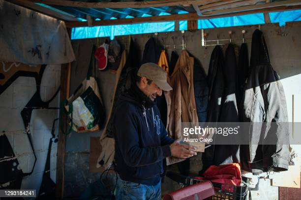 Carlos Miguel Moreira in his wooden and cardboard house located in an industrial park on December 25, 2020 in Zaragoza, Spain. A new level of poverty...