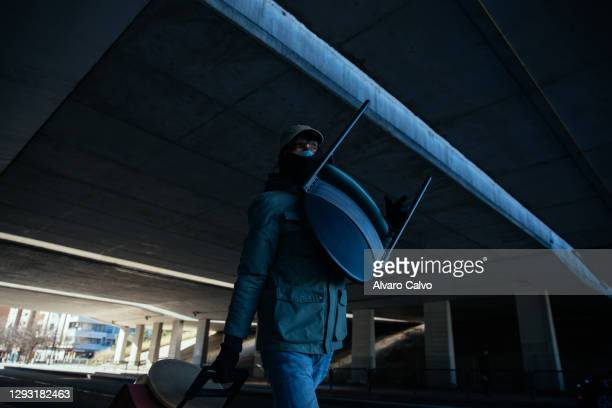 Carlos Miguel Moreira, wearing a protective mask of Covid-19, returns to his cabin with objects left in the rubbish containers on December 25, 2020...