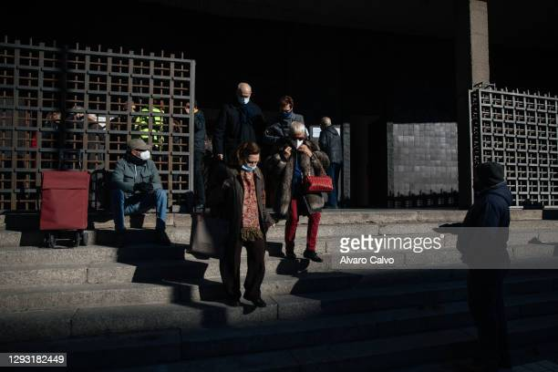 Carlos Miguel Moreira, wearing a protective mask of Covid-19, sitting on the steps of the parish of Carmen asking for alms and charity at the end of...