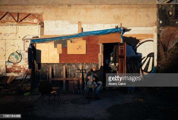 Carlos Miguel Moreirra in his wooden and cardboard house located in an industrial park on December 25, 2020 in Zaragoza, Spain. A new level of...