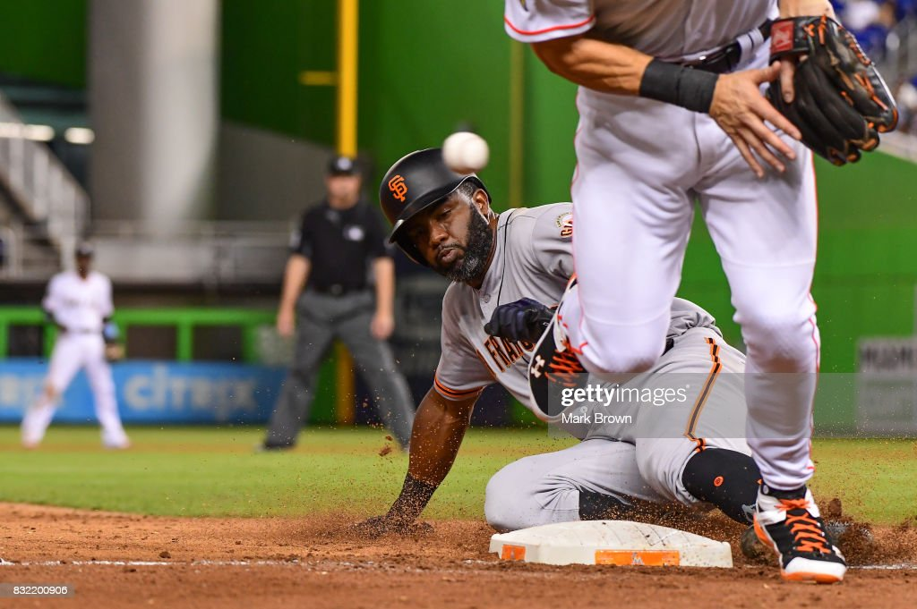 Carlos Moncrief #39 of the San Francisco Giants steals third in the seventh inning during the game between the Miami Marlins and the San Francisco Giants at Marlins Park on August 15, 2017 in Miami, Florida.