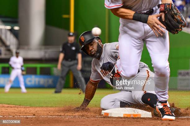 Carlos Moncrief of the San Francisco Giants steals third in the seventh inning during the game between the Miami Marlins and the San Francisco Giants...