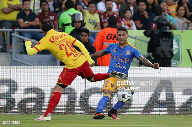 Carlos Morales of Morelia vies for the ball with Victor Sosa of Tigres during their Mexican Apertura 2016 tournament football match at the Jose Maria...