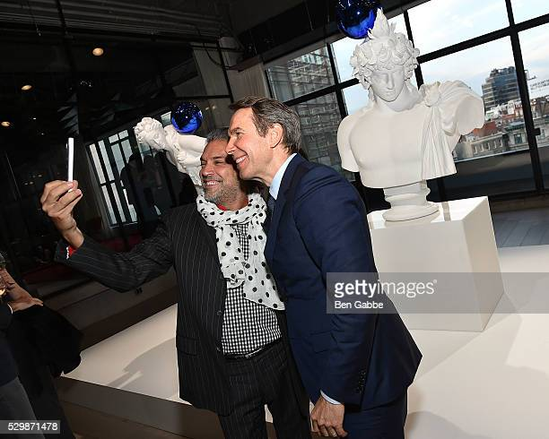 Carlos Mota and artist Jeff Koons take a selfy at the Jeff Koons x Google launch on May 09 2016 in New York New York