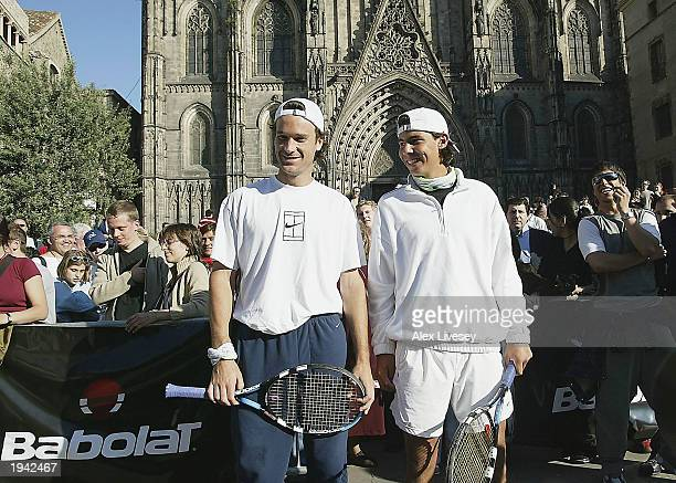 Carlos Moya and Rafael Nadal of Spain play tennis in front of Barcelona Cathedral for a Babolat sponsered tennis clinic at the Plaza de la Catedral...