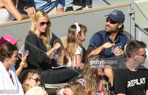 Carlos Moya coach of Rafael Nadal of Spain comes to see his wife Carolina Cerezuela and children during a break in Nadal's match on day 6 of the 2019...