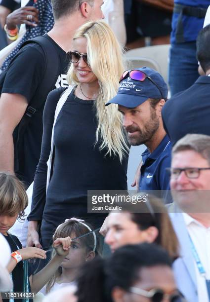 Carlos Moya coach of Rafael Nadal of Spain with his wife Carolina Cerezuela and children following the victory of Nadal during day 6 of the 2019...