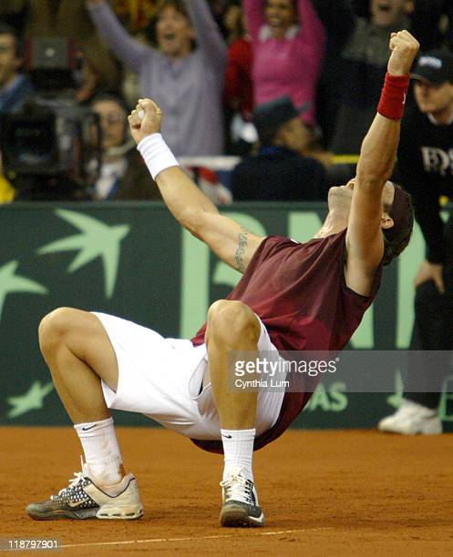 Carlos Moya defeats Andy Roddick 62 76 76 cinching the Davis Cup Championship for Spain on December 5 2004 in Seville Spain at Estadio Olimpico de...