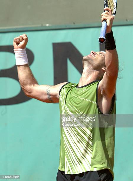 Carlos Moya defeats countryman Fernando Vicente 6-4, 7-6, 6-7, 0-6, 6-4 in the 3rd round of the Paris Open on the May 27, 2005