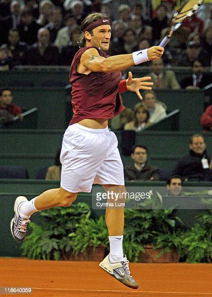 Carlos Moya during the opening round match of the Davis Cup against Mardy Fish at the Olympic Stadium in in Seville Spain on December 3 2004 Moya...
