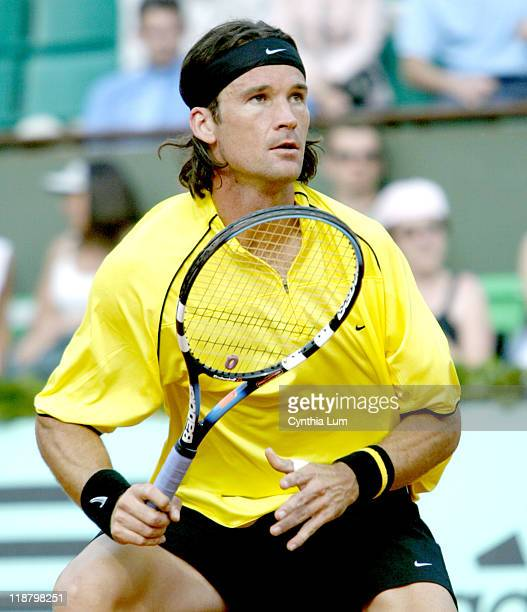 Carlos Moya in action at the 2004 Roland Garros. Carlos Moya won his third round match against Rainer Sluiter 6-0, 6-3, 6-1.