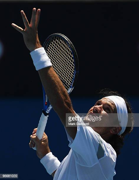 Carlos Moya of Spain hits a serve during his practice session at Melbourne Park on January 11 2010 in Melbourne Australia