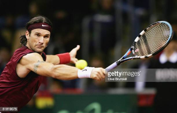 Carlos Moya of Spain in action during his straight sets victory over Mardy Fish of the USA in the first rubber during the Davis Cup by BNP...