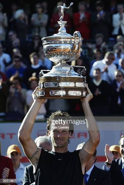 Carlos Moya of Spain lifts the trophy up after winning the Final of the ATP Seat Open held on April 27 2003 at the Real Club de Tenis in Barcelona...