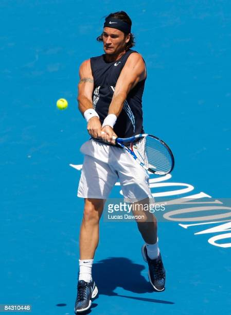 Carlos Moya of Spain plays a backhand shot in his third round match against Ivan Ljubicic of Croatia during day three of the AAMI Classic at the...
