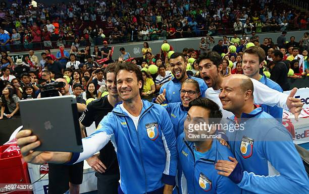 Carlos Moya of the Manila Mavericks takes a team selfie after their victory over the Singapore Slammers during the CocaCola International Premier...