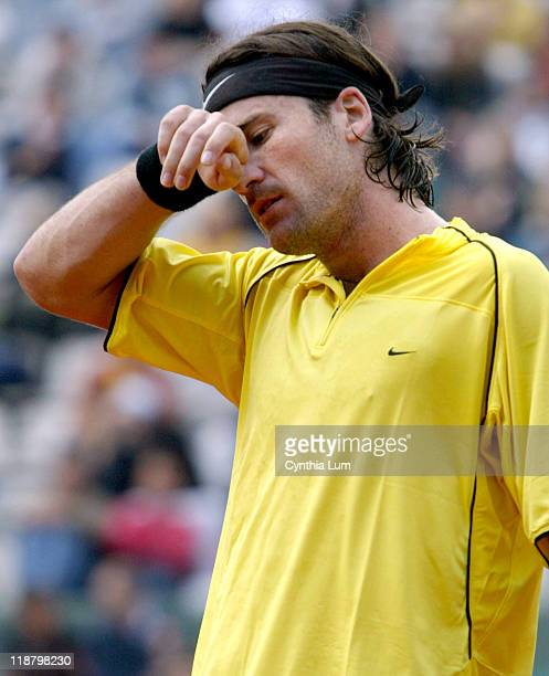 Carlos Moya out of the French Open with a 5-7, 6-7, 3-6 loss to Guillermo Coria on June 1, 2004