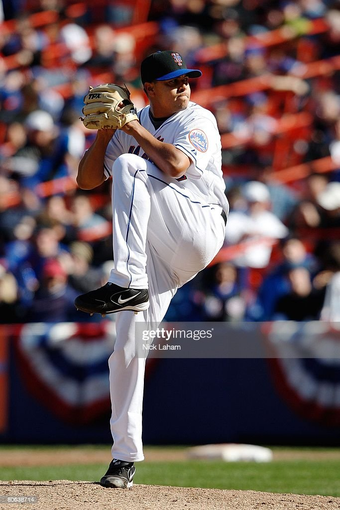 Carlos Muniz of the New York Mets pitches against the Philadelphia Phillies during the last home opener at Shea Stadium on April 8, 2008 in the Flushing neighborhood of the Queens borough of New York City.