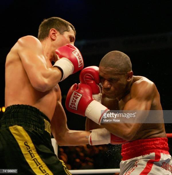 Carlos Nascimento of Brazil and Sergiy Dzinziruk of Ukraine compete during the WBO super welterweight championship between Sergiy Dzinziruk of...