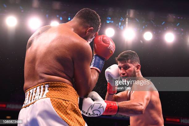 Carlos Negron punches Dominic Breazeale during their Heavyweights bout at Barclays Center on December 22 2018 in the Brooklyn borough of New York City