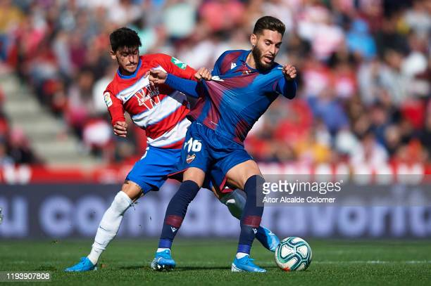 Carlos Neva of Granada CF competes for the ball with Ruben Rochina of Levante UD during the Liga match between Granada CF vs Levante UD at Nuevo...