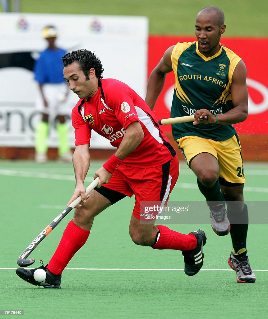 Carlos Nevado of South Africa and Julian Hykes of Germany during the Five Nations Mens Hockey tournament match between South Africa and Germany held at the North West University hockey centre on January 23, 2008 in Potchefstroom, South Africa.