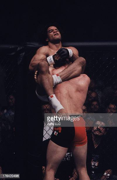 Carlos Newton attempts to submit Matt Hughes with a triangle choke submission during their welterweight championship bout at UFC 34 inside the MGM...