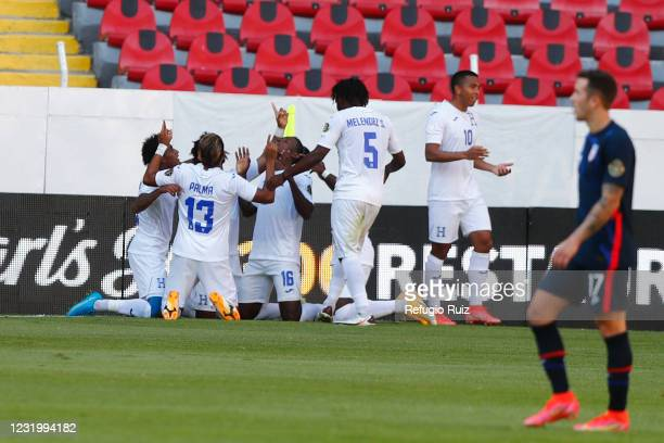 Carlos Obregón of Honduras celebrates with his teammates after scoring the first goal of his team during the semifinals match between Honduras and...