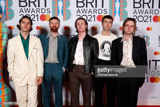 Carlos O'Connell, Tom Coll, Conor Curley, Grian Chatten and Conor Deegan III of Fontaines DC arrives at The BRIT Awards 2021 at The O2 Arena on May...