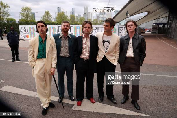 Carlos O'Connell, Tom Coll, Conor Deegan III, Grian Chatten and Conor Curley of Fontaines DC arrive at The BRIT Awards 2021 at The O2 Arena on May...