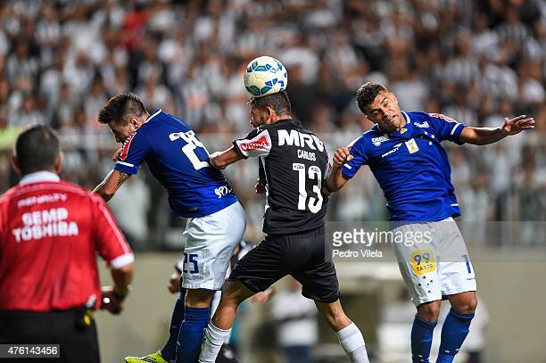 Carlos of Atletico MG and Willian and Alisson of Cruzeiro battle for the ball during a match between Atletico MG and Cruzeiro as part of Brasileirao...