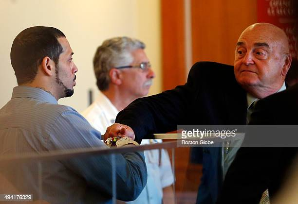 Carlos Ortiz left shakes hands with his defense attorney John Connors during his arraignment hearing at Fall River Superior Court Tuesday May 27 in...