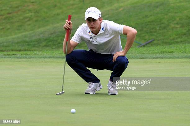 Carlos Ortiz of Mexico lines up a putt on the ninth green during the first round of the John Deere Classic at TPC Deere Run on August 11 2016 in...