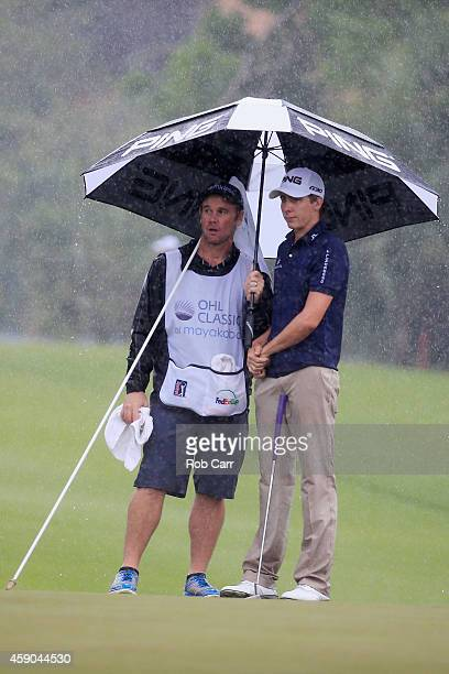 Carlos Ortiz of Mexico stands with his caddie on the 17th green during the third round of the OHL Classic at Mayakoba on November 15 2014 in Playa...