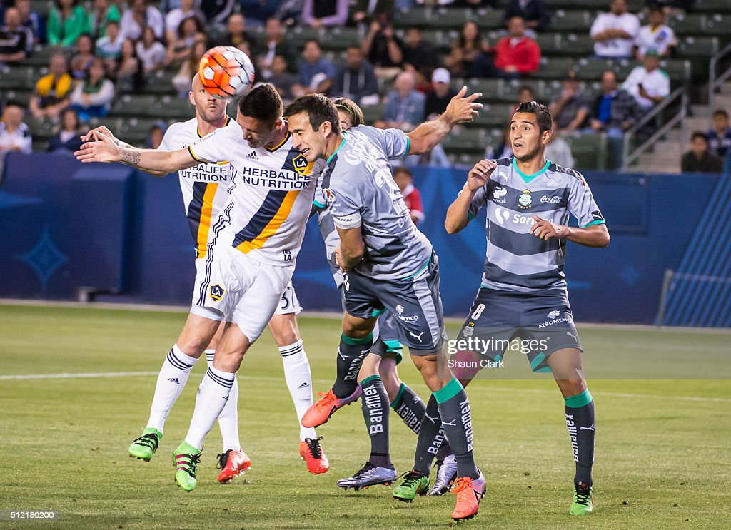 Carlos Ozquierdoz #24 of Santos Laguna defends as Robbie Keane #7 of Los Angeles Galaxy attempts to get on the end of a cross during the CONCACAF Champions League match between Santos Laguna and Los Angeles Galaxy at the StubHub Center on February 24, 2016 in Carson, California. The final score was 0-0