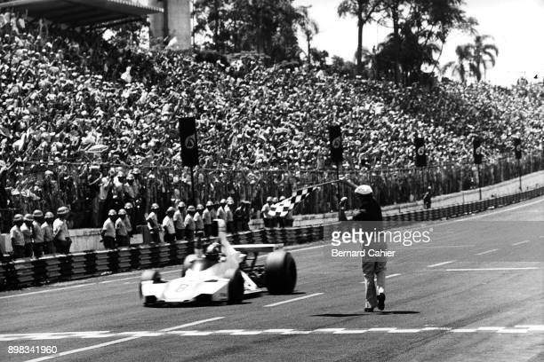 Carlos Pace, Brabham-Ford BT44B, Grand Prix of Brazil, Interlagos, 26 January 1975. Carlos Pace take the checkered flag and victory in the 1975...