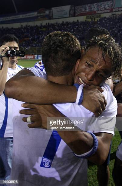 Carlos Pavon of Honduras celebrates with team mate the victory against El Salvador as part of the 2010 FIFA World Cup Qualifier at Cuscatlan Stadium...