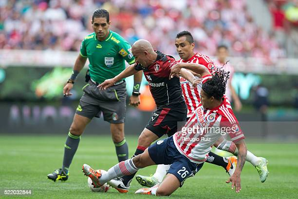 Carlos Peña of Chivas fights for the ball with Egidio Arévalo of Atlas during the 14th round match between Chivas and Atlas as part of the Clausura...