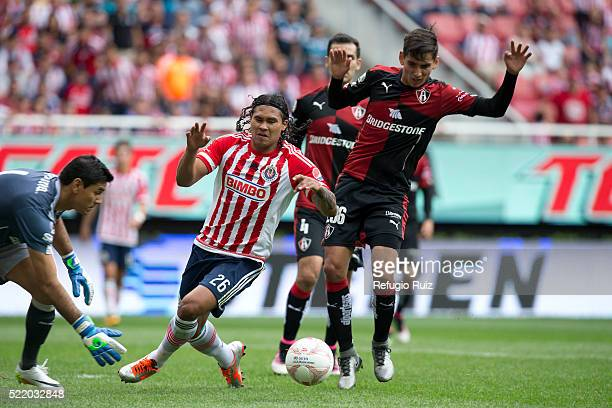 Carlos Peña of Chivas fights for the ball with Gaddi Aguirre of Atlas during the 14th round match between Chivas and Atlas as part of the Clausura...