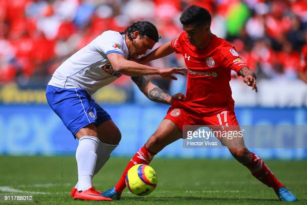 Carlos Peña of Cruz Azul struggles for the ball with Leonel Lopez of Toluca during the 4th round match between Toluca and Cruz Azul as part of the...