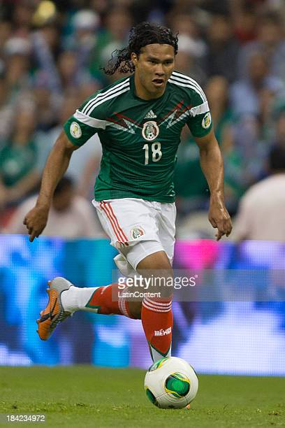Carlos Peña of Mexico receives the ball during a match between Mexico and Panama as part of the CONCACAF Qualifyers at Azteca stadium on October 11...