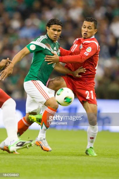 Carlos Peña of Mexico struggles for the ball with Amilcar Henriquez of Panama during a match between Mexico and Panama as part of the CONCACAF...