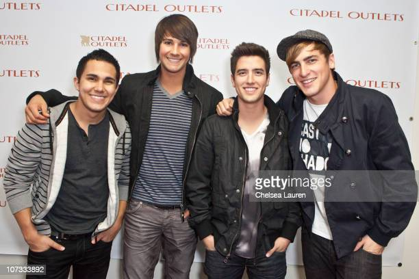 Carlos Pena Jr James Maslow Logan Henderson and Kendall Schmidt of Big Time Rush pose backstage at the Citadel Outlets on December 4 2010 in Los...