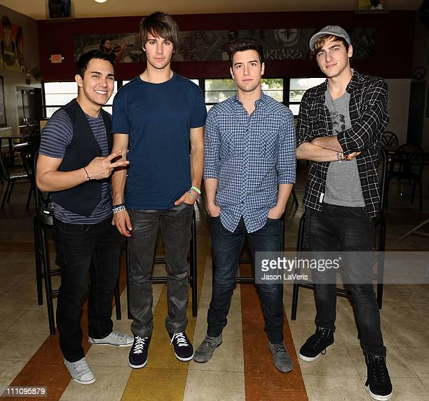 Carlos Pena Jr James Maslow Logan Henderson and Kendall Schmidt of Big Time Rush pose for a photo after their performance at Torrance High School on...