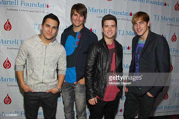 Carlos Pena Jr James Maslow Logan Henderson and Kendall Schmidt of Big Time Rush attend the TJ Martell Foundation's 12th annual family day at...