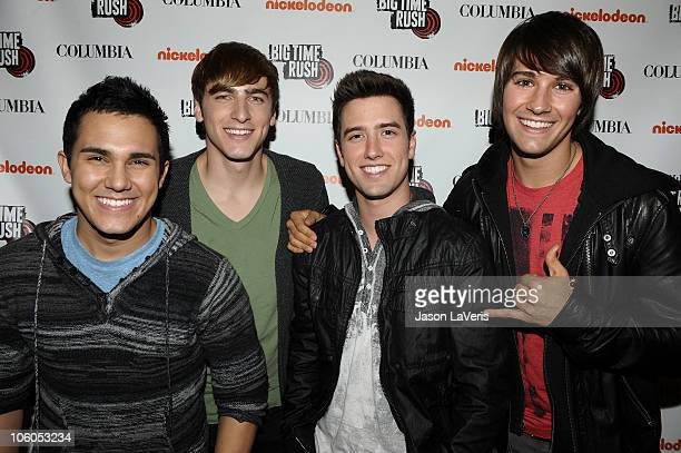 Carlos Pena Jr Kendall Schmidt Logan Henderson and James Maslow of 'Big Time Rush' sign autographs at Universal CityWalk on October 25 2010 in...